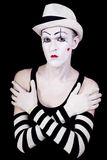 Serious theatrical clown in white hat Royalty Free Stock Photos