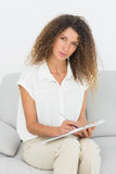 Serious therapist looking at camera taking notes Stock Images