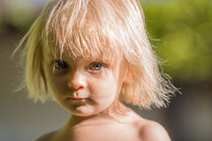 Serious thinking or sad young baby caucasian blonde real people girl close portrait outdoor.  Stock Images