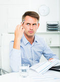 Serious thinking young man working with laptop Royalty Free Stock Photos