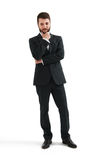 Serious thoughtful businessman. In formal wear holding his hand at chin and looking down. isolated on white background stock photos