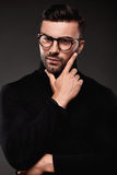 Serious thoughtful handsome man in golf and glasses Royalty Free Stock Photo