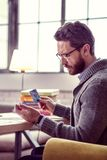 Serious thoughtful man reading the meaning of the card. This is a sign. Serious thoughtful man reading the meaning of the card while having a fortunetelling royalty free stock photography