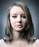 Serious thoughtful woman showing tongue Royalty Free Stock Photos