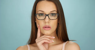 Serious thoughtful young woman wearing glasses Stock Photography