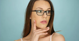 Serious thoughtful young woman wearing glasses Royalty Free Stock Images