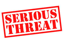 SERIOUS THREAT. Red Rubber Stamp over a white background Stock Photos