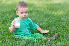 Serious toddler drinking milk Royalty Free Stock Photography