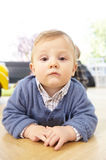 Serious Toddler Lying on the Floor Royalty Free Stock Images