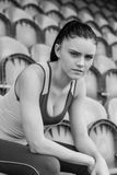 Serious toned woman sitting on chair in the stadium Royalty Free Stock Images