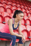 Serious toned woman sitting on chair in the stadium Stock Photos