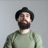 Serious tough bearded macho man looking at camera Stock Photography