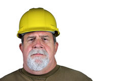 Serious Tough Construction Worker. A serious construction worker isolated on a white background Stock Photo