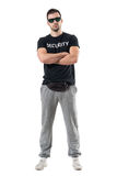 Serious tough macho police man in civil clothes with crossed arms looking at camera. Full body length portrait isolated on white studio background Royalty Free Stock Photography