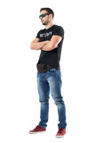Serious tough macho undercover cop or bouncer with crossed arms looking away. Full body length portrait isolated on white studio background Stock Photo
