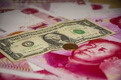 Serious trade tension or trade war between US and China, financial concept :. Banknotes of USA and China currencies Royalty Free Stock Photography