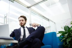 Serious trader. Professional salesman or trader working in office royalty free stock photo