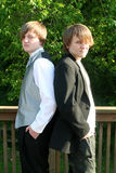 Serious Tuxedoed and Casual Teens Royalty Free Stock Photos