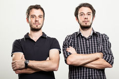 Serious Twins. Two Serious Twins with Arms Folded Stock Photos
