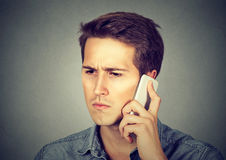Serious upset man having mobile phone conversation Royalty Free Stock Photos