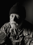 Serious Veteran wearing a camo jacket and knit hat Stock Photography