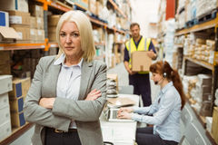 Serious warehouse manager standing arms crossed Royalty Free Stock Photography