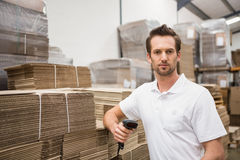 Serious warehouse worker holding scanner Stock Image