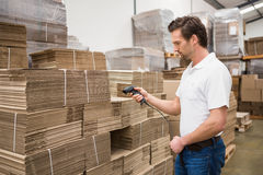 Serious warehouse worker holding scanner Stock Photos