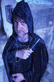Serious Warlock with Dagger. Serious male warlock in cloak with dagger Stock Photo