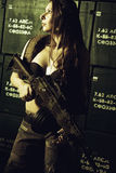 Serious weapon girl Royalty Free Stock Photo