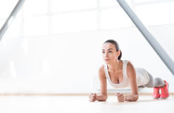 Serious well built woman training royalty free stock image