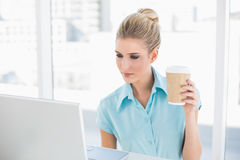 Serious well dressed businesswoman holding coffee Stock Photo