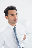 Serious well dressed man drinking coffee Stock Photos