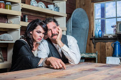 Serious Western Sheriff and Woman Pose Inside House Royalty Free Stock Photos