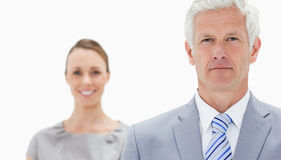 A serious white hair businessman with a woman Stock Image