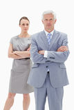 Serious white hair businessman with a woman Royalty Free Stock Images
