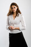 Serious woman. Neutral looking standing woman on white background Stock Photography