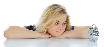 The serious woman and alarm clock. Stock Image
