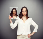 Serious woman angry inside Stock Photography