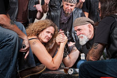Serious Woman Arm Wrestling Stock Image