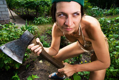 Serious woman with an ax Stock Photos