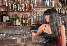 Serious Woman in Bar with Drink Royalty Free Stock Images