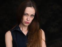 Serious woman black background Stock Photos