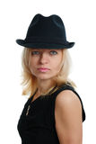 Serious woman with a black hat Stock Photography