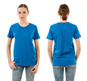 Serious woman with blank blue shirt Royalty Free Stock Photos