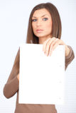 Serious woman with blank card Stock Photo