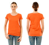 Serious woman with blank orange shirt Stock Photography