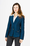 Serious woman in blue jacket standing Royalty Free Stock Images