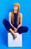 Serious woman in blue jumpsuit and straw hat Royalty Free Stock Photography