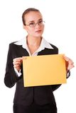 Serious woman in business suit with yellow paper Stock Image